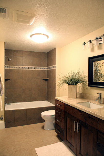 Mid-sized elegant 3/4 beige tile and porcelain tile porcelain floor bathroom photo in Salt Lake City with an undermount sink, shaker cabinets, dark wood cabinets, engineered quartz countertops and beige walls