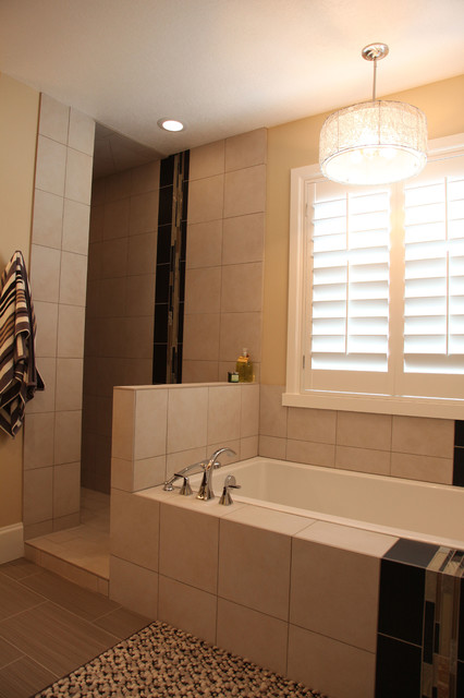 Inspiration for a mid-sized timeless master gray tile and porcelain tile bathroom remodel in Salt Lake City with an undermount sink, shaker cabinets, dark wood cabinets, engineered quartz countertops and beige walls