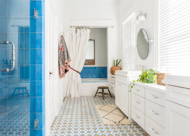 Mid-sized southwest master blue tile and ceramic tile ceramic floor and multicolored floor bathroom photo in Houston with shaker cabinets, white cabinets, white walls, a hinged shower door and a drop-in sink