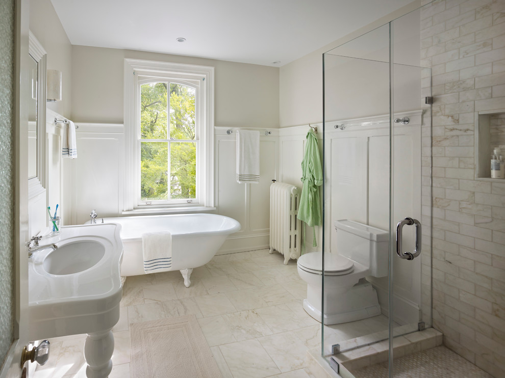 Example of a classic claw-foot bathtub design in Philadelphia with a console sink
