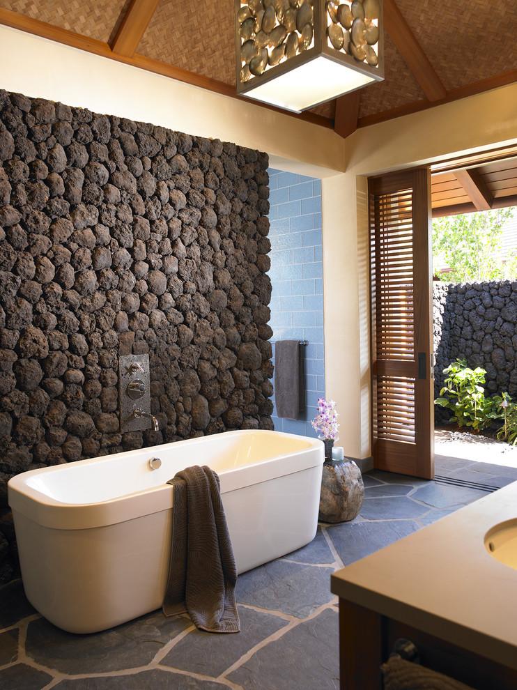 Island style slate floor freestanding bathtub photo in Hawaii