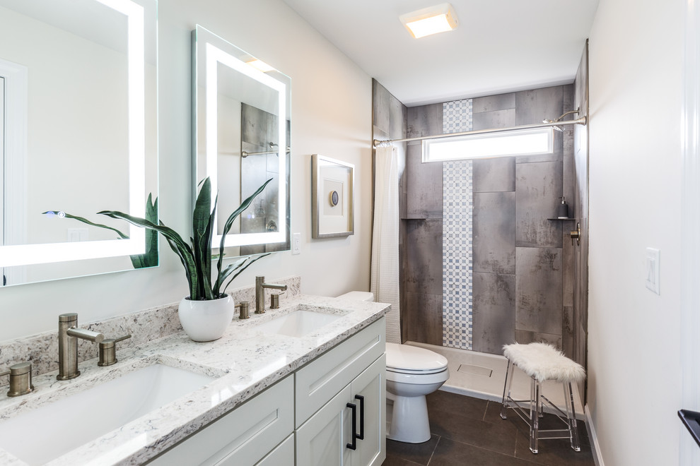 Transitional gray tile gray floor and double-sink bathroom photo in Cincinnati with shaker cabinets, white cabinets, white walls, an undermount sink and white countertops