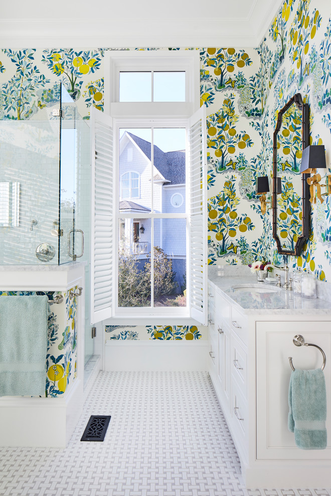 Corner shower - coastal master white tile and porcelain tile porcelain tile and white floor corner shower idea in Charleston with beaded inset cabinets, white cabinets, multicolored walls, an undermount sink, marble countertops, a hinged shower door and gray countertops