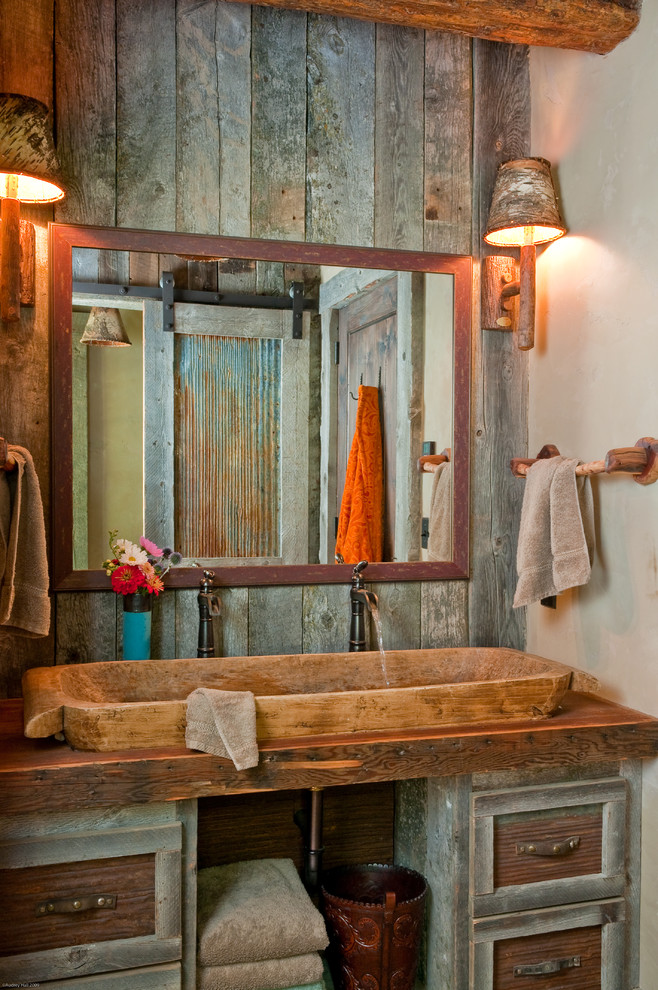 Example of a mountain style bathroom design in Other with wood countertops and brown countertops