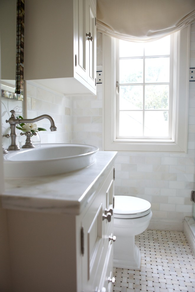 Example of a classic bathroom design in Raleigh with marble countertops and a vessel sink