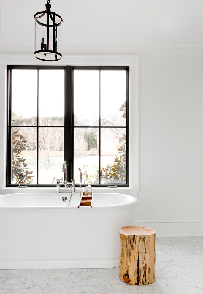 Bathroom - large scandinavian master gray tile, white tile and stone slab gray floor and marble floor bathroom idea in New York with white walls, furniture-like cabinets, black cabinets, an undermount sink, marble countertops and a hinged shower door