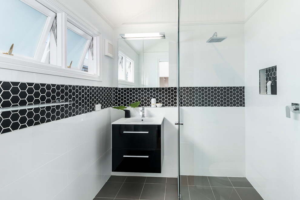 Example of a small trendy 3/4 black and white tile ceramic tile walk-in shower design in Brisbane with flat-panel cabinets, black cabinets and white walls