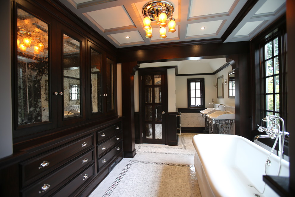 Elegant freestanding bathtub photo in New York with a console sink