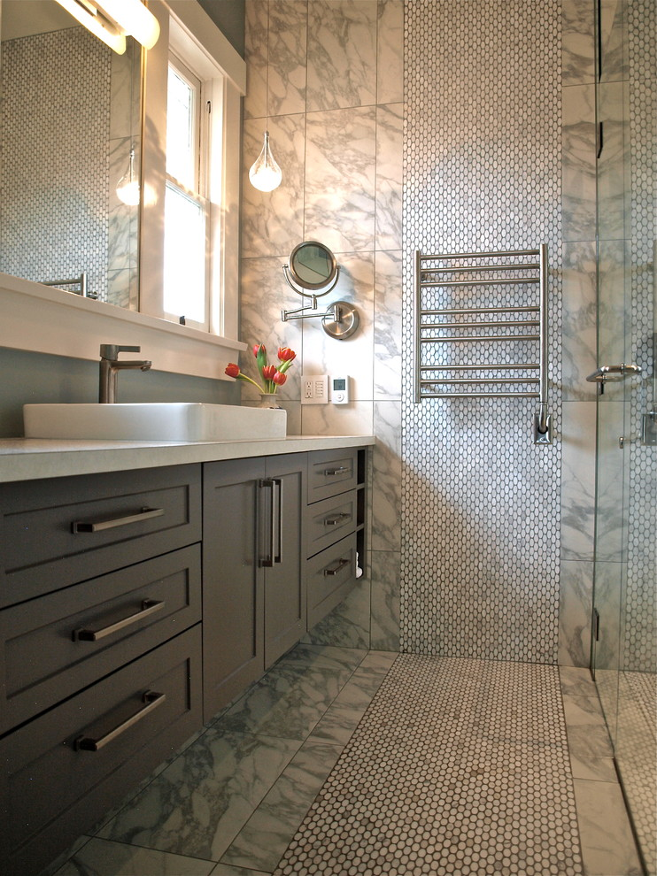 Example of a mid-sized transitional master gray tile and stone tile marble floor bathroom design in Vancouver with a vessel sink, shaker cabinets, gray cabinets, quartz countertops, a two-piece toilet and gray walls