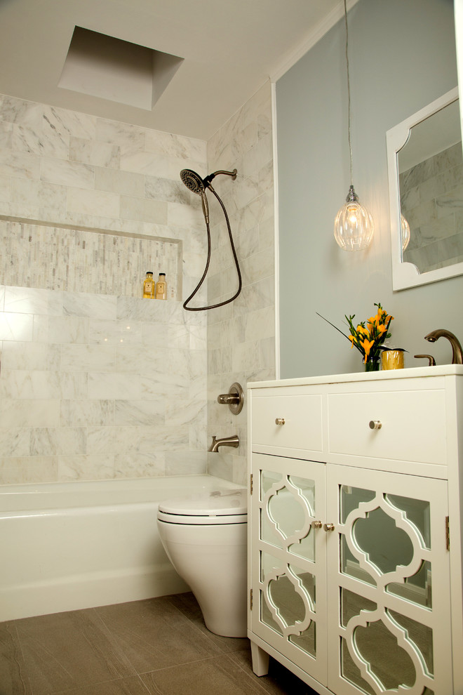 Bathroom - small transitional gray tile and stone tile porcelain floor bathroom idea in Los Angeles with an undermount sink, furniture-like cabinets, white cabinets, quartzite countertops, a one-piece toilet and gray walls