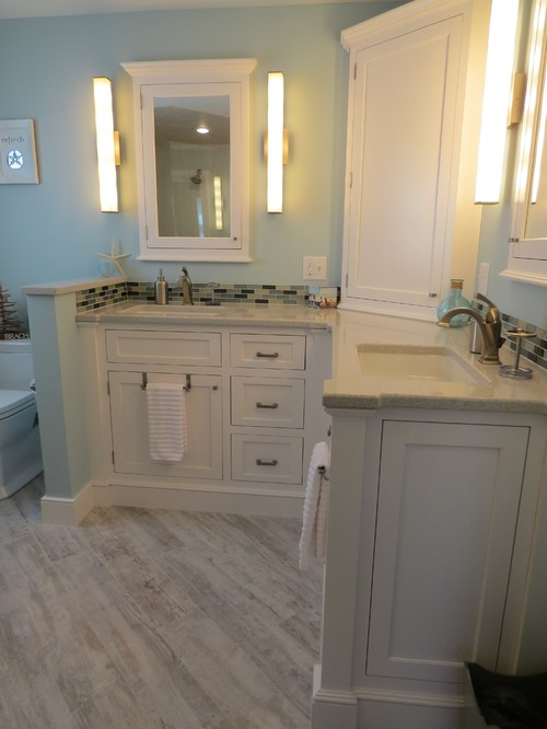 The Soft Blue And Greens Of This Bathroom Compliment The White Vanity,  Which Has A