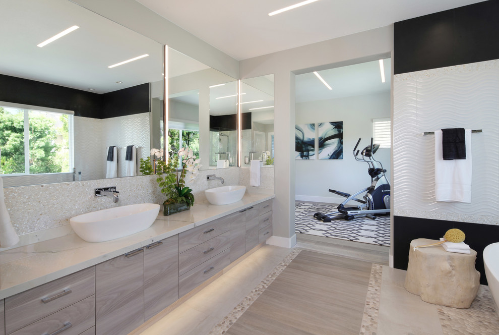 Bathroom - coastal porcelain tile bathroom idea in Orange County with flat-panel cabinets, gray cabinets and a vessel sink