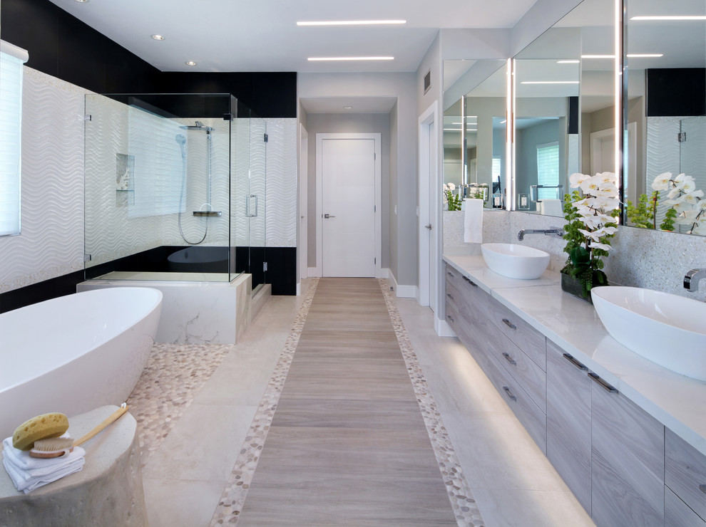 Inspiration for a coastal porcelain tile bathroom remodel in Orange County with flat-panel cabinets, gray cabinets and a vessel sink