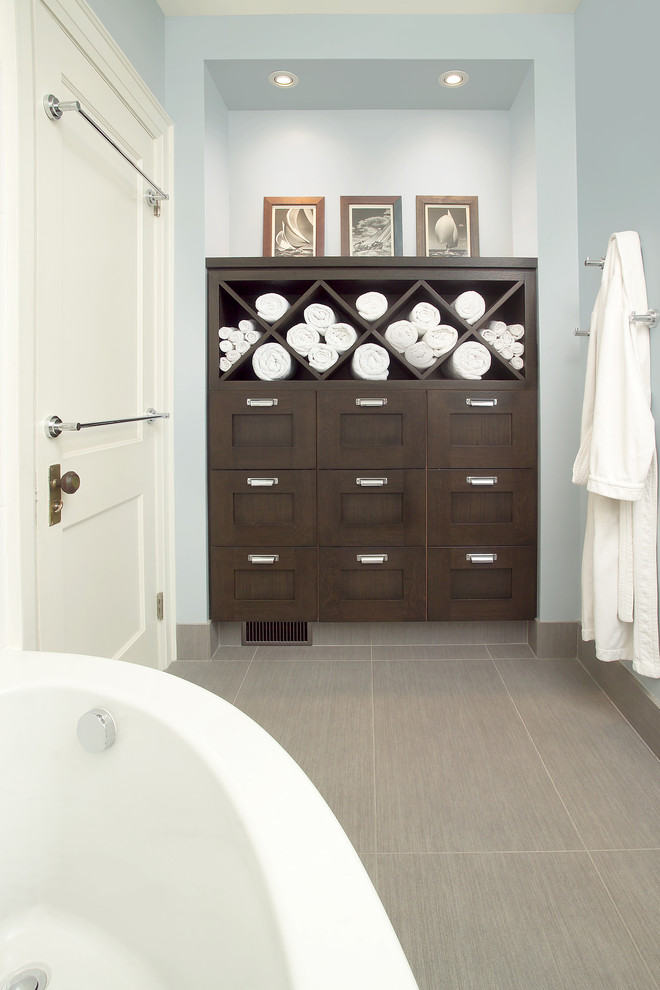 Example of a transitional gray tile and porcelain tile porcelain tile corner bathtub design in Toronto with dark wood cabinets, wood countertops and shaker cabinets
