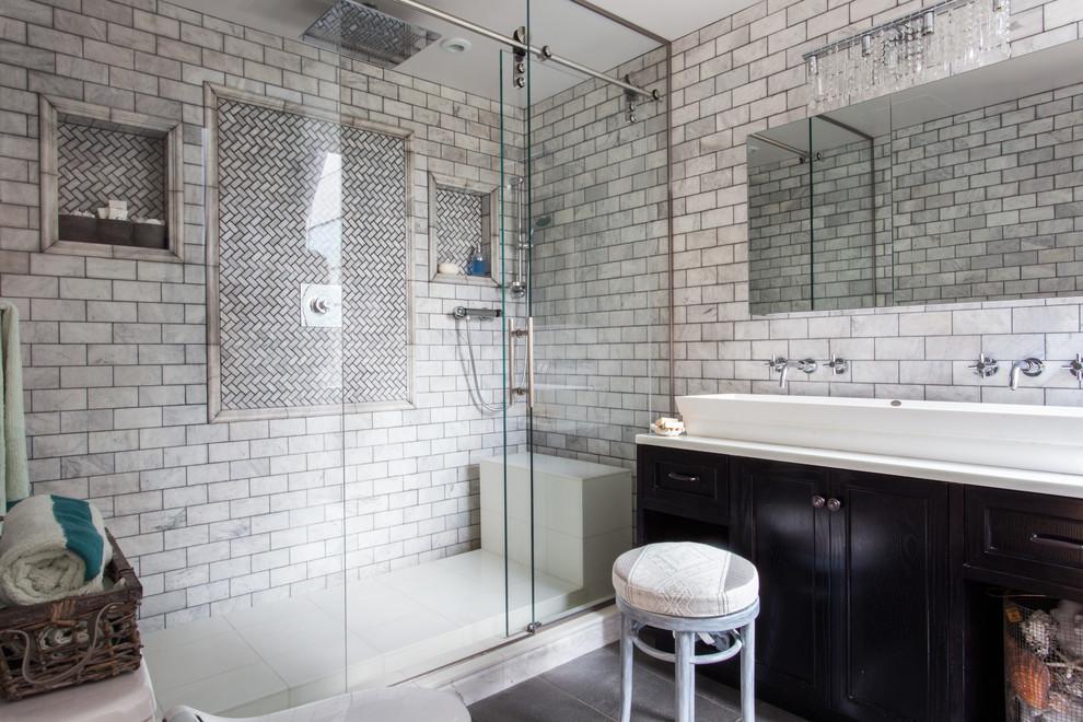 Bathroom - contemporary subway tile bathroom idea in New York with a vessel sink