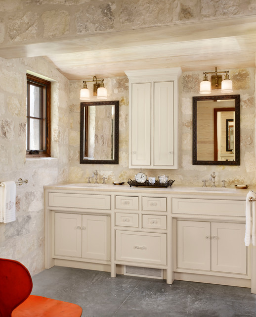 Inspiration for a cottage stone tile bathroom remodel in Houston with an undermount sink, beaded inset cabinets and beige cabinets
