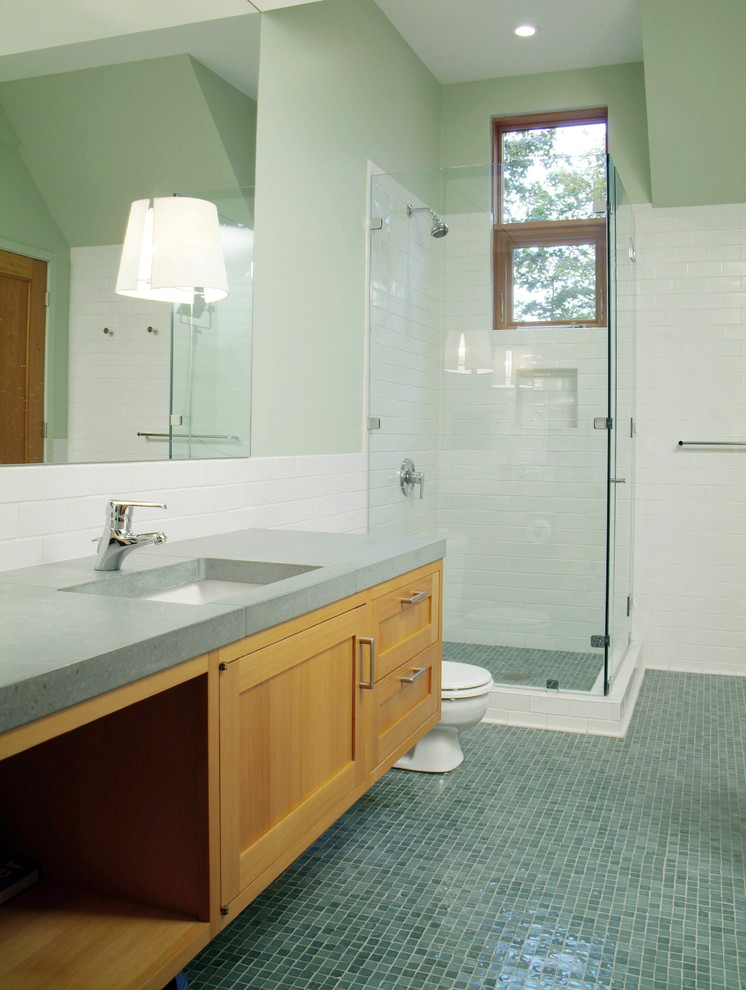 Corner shower - large rustic master mosaic tile and blue tile blue floor corner shower idea in Burlington with concrete countertops, recessed-panel cabinets, light wood cabinets, a two-piece toilet, green walls, an undermount sink, a hinged shower door and green countertops