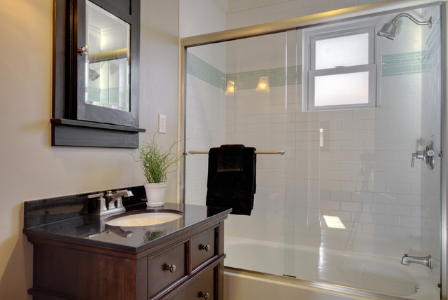 Bathroom - mid-sized eclectic white tile and subway tile bathroom idea in Denver with recessed-panel cabinets, dark wood cabinets and an undermount sink