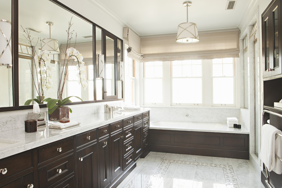 Elegant alcove bathtub photo in Los Angeles with recessed-panel cabinets and dark wood cabinets
