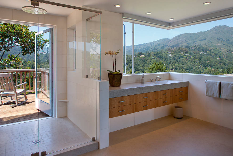 Example of an eclectic alcove shower design in San Francisco with an integrated sink, flat-panel cabinets and medium tone wood cabinets