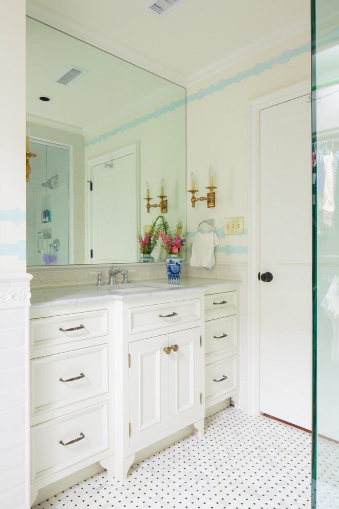 Bathroom - traditional mosaic tile floor bathroom idea in Other with an undermount sink, recessed-panel cabinets, white cabinets and white walls
