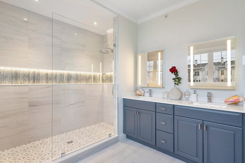 Mid-sized transitional master gray tile and porcelain tile porcelain tile and gray floor bathroom photo in Boston with raised-panel cabinets, gray cabinets, gray walls, an undermount sink, quartz countertops and white countertops