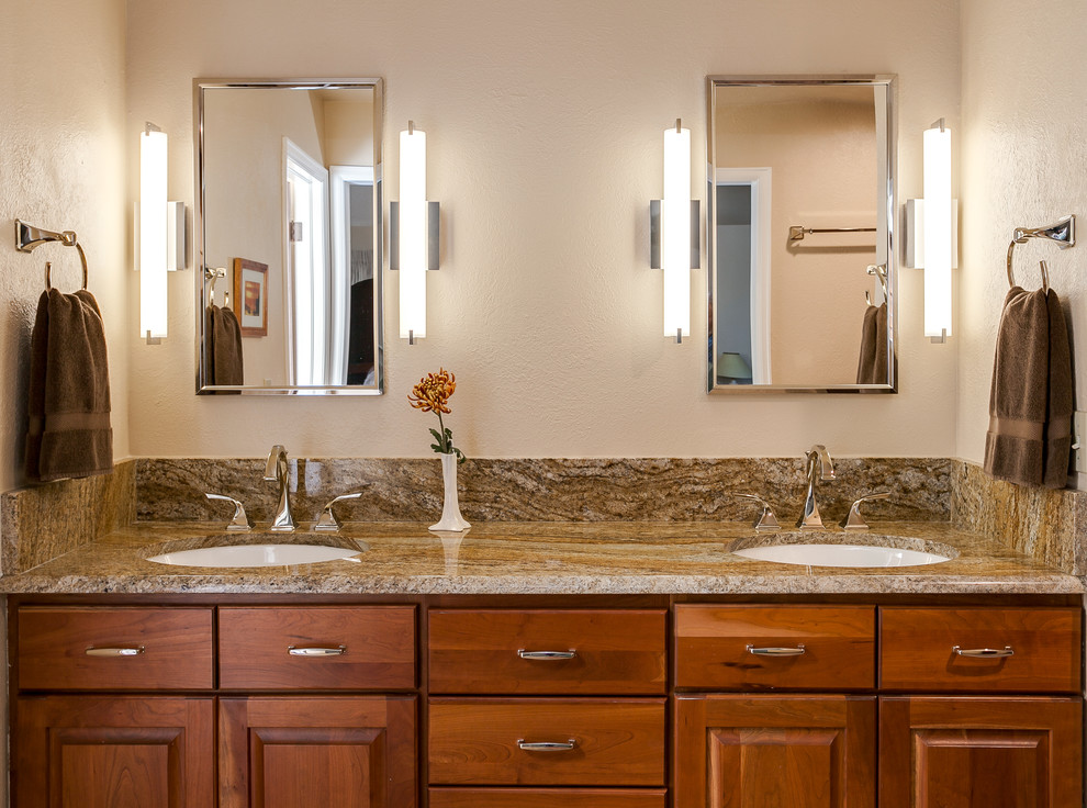 Inspiration for a large modern master brown tile and ceramic tile ceramic tile bathroom remodel in Denver with raised-panel cabinets, medium tone wood cabinets, granite countertops and beige walls