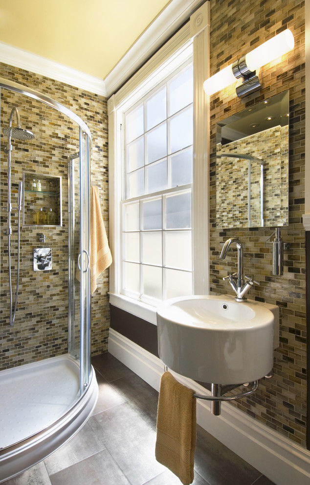 Trendy glass tile and brown tile bathroom photo in San Francisco with a wall-mount sink
