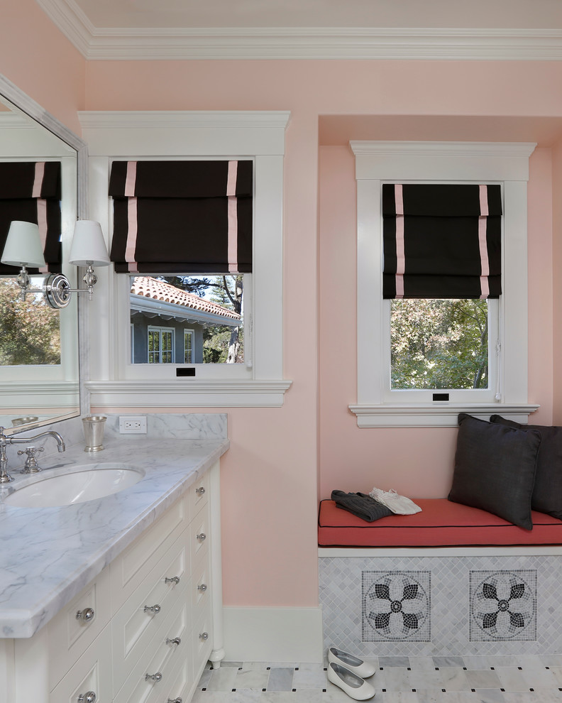Example of a tuscan gray tile bathroom design in San Francisco with an undermount sink, recessed-panel cabinets, white cabinets and pink walls