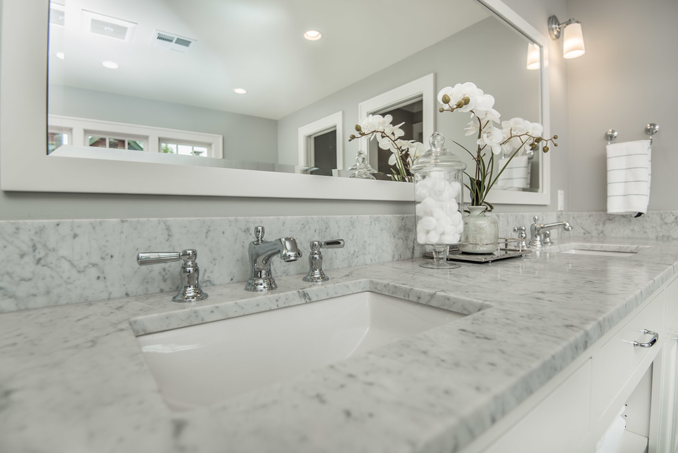 Example of a huge transitional master gray tile and marble tile marble floor and gray floor bathroom design in Portland with recessed-panel cabinets, white cabinets, a one-piece toilet, gray walls, an undermount sink, marble countertops and a hinged shower door