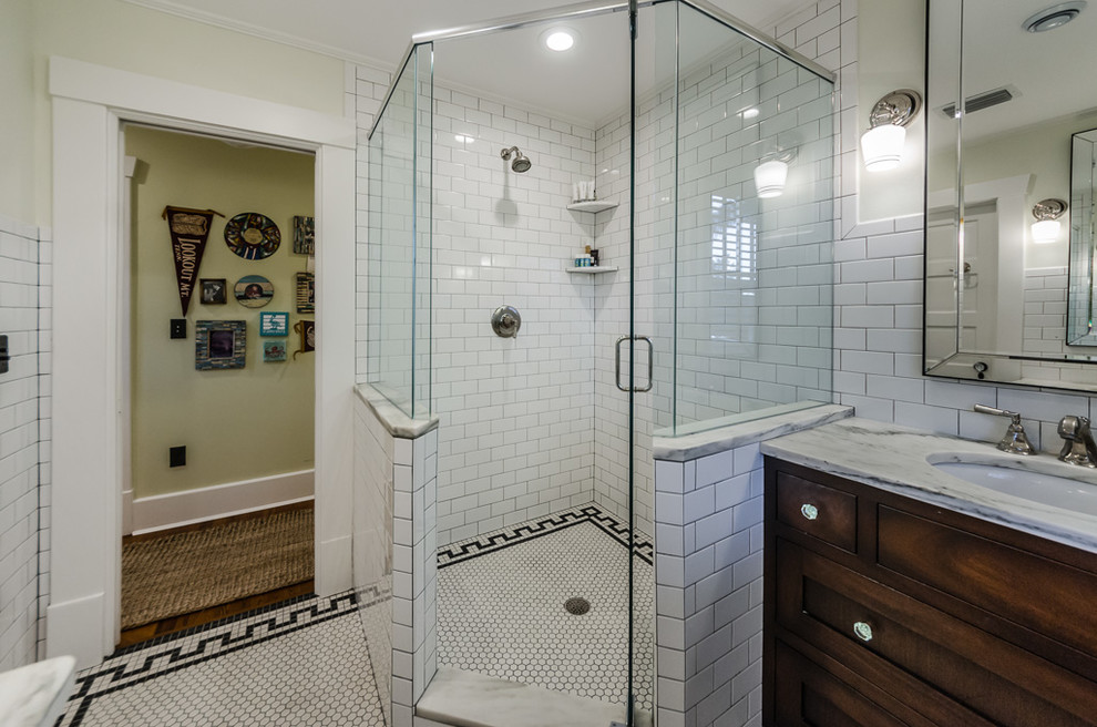 Inspiration for a timeless white tile and subway tile ceramic tile and white floor corner shower remodel in Tampa with shaker cabinets, dark wood cabinets, beige walls, an undermount sink, a hinged shower door and gray countertops