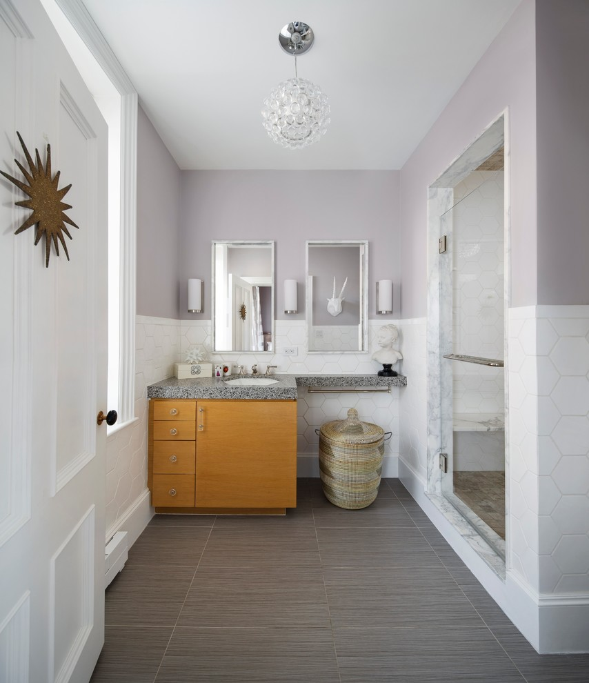 Alcove shower - mid-sized transitional 3/4 white tile and ceramic tile ceramic tile and gray floor alcove shower idea in Boston with an undermount sink, flat-panel cabinets, medium tone wood cabinets, solid surface countertops and purple walls