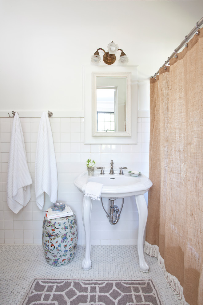 Example of a small classic white tile and ceramic tile ceramic tile bathroom design in Atlanta with white walls and a console sink