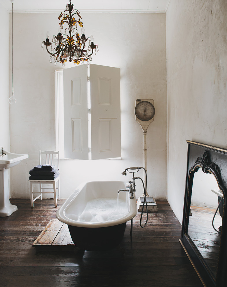 Example of a mid-sized eclectic 3/4 dark wood floor claw-foot bathtub design in Sydney with a pedestal sink and white walls