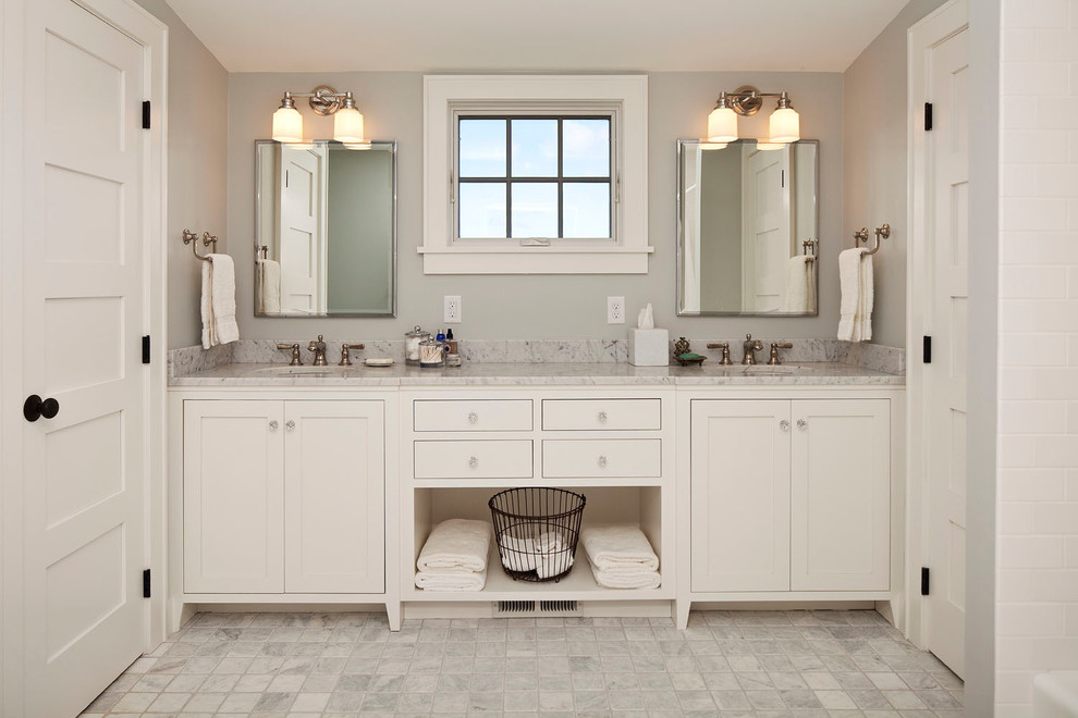 Bathroom - country bathroom idea in Minneapolis with an undermount sink, shaker cabinets, white cabinets and gray walls