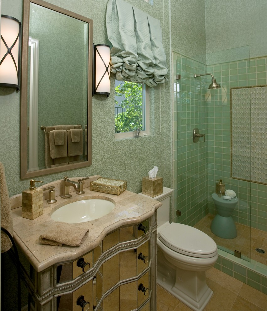 Example of a mid-sized trendy 3/4 green tile and ceramic tile travertine floor and beige floor alcove shower design in Sacramento with an undermount sink, glass-front cabinets, a two-piece toilet, green walls, marble countertops, a hinged shower door and beige countertops