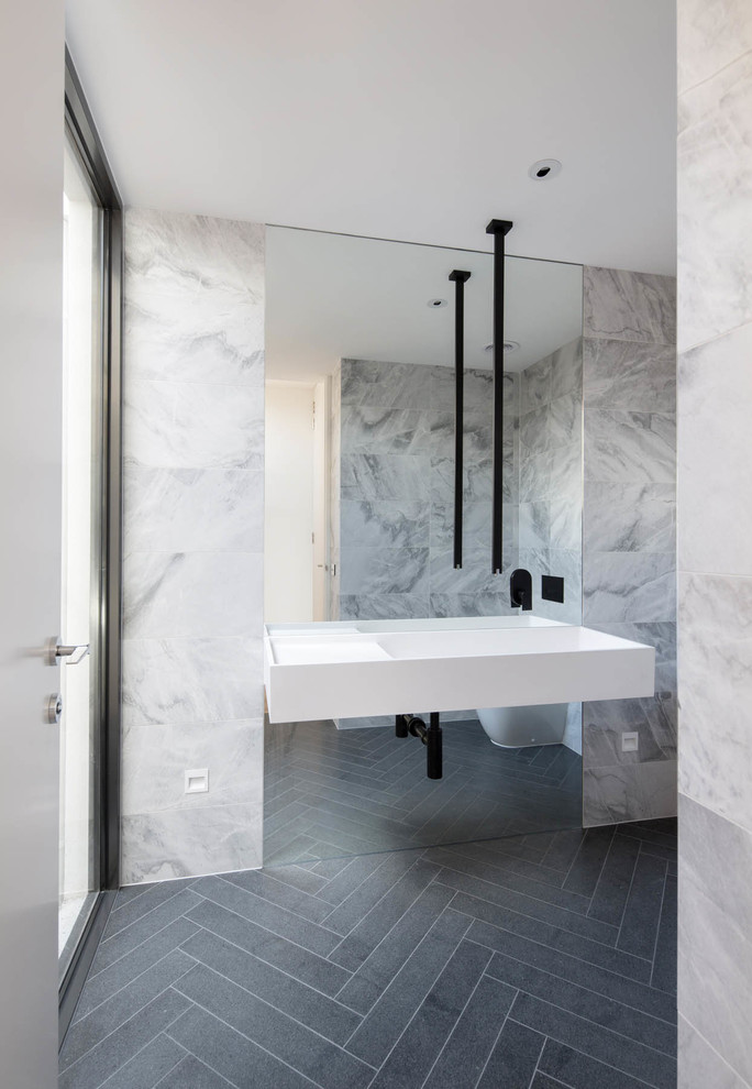 Example of a trendy black floor bathroom design in Melbourne with a wall-mount sink