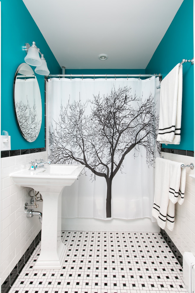 Example of a classic 3/4 black and white tile and subway tile mosaic tile floor and multicolored floor bathroom design in DC Metro with blue walls and a pedestal sink