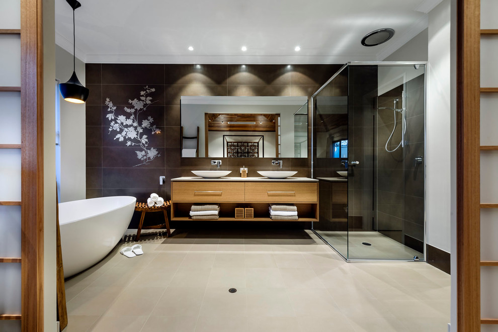 Inspiration for a large master black tile bathroom remodel in Perth with a vessel sink, flat-panel cabinets and medium tone wood cabinets