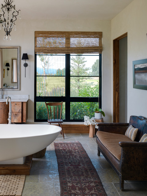 Large mountain style master stone tile freestanding bathtub photo in Other with flat-panel cabinets, medium tone wood cabinets, white walls, an undermount sink and marble countertops