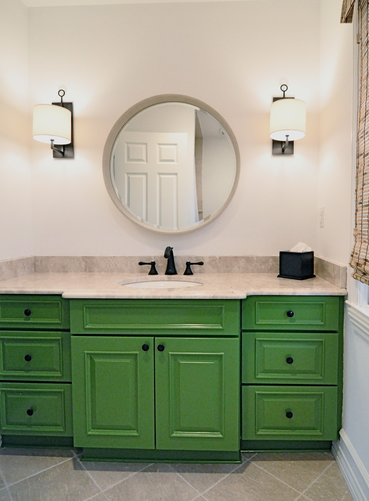 Inspiration for a mid-sized kids' beige tile and ceramic tile ceramic tile drop-in bathtub remodel in New York with an undermount sink, raised-panel cabinets, green cabinets, limestone countertops and white walls