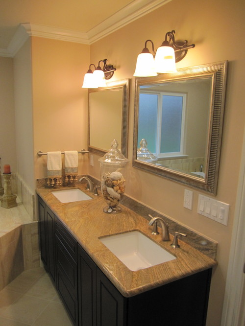 lighting a match in the bathroom does that light fixture finish match the faucet i cant tell 25593