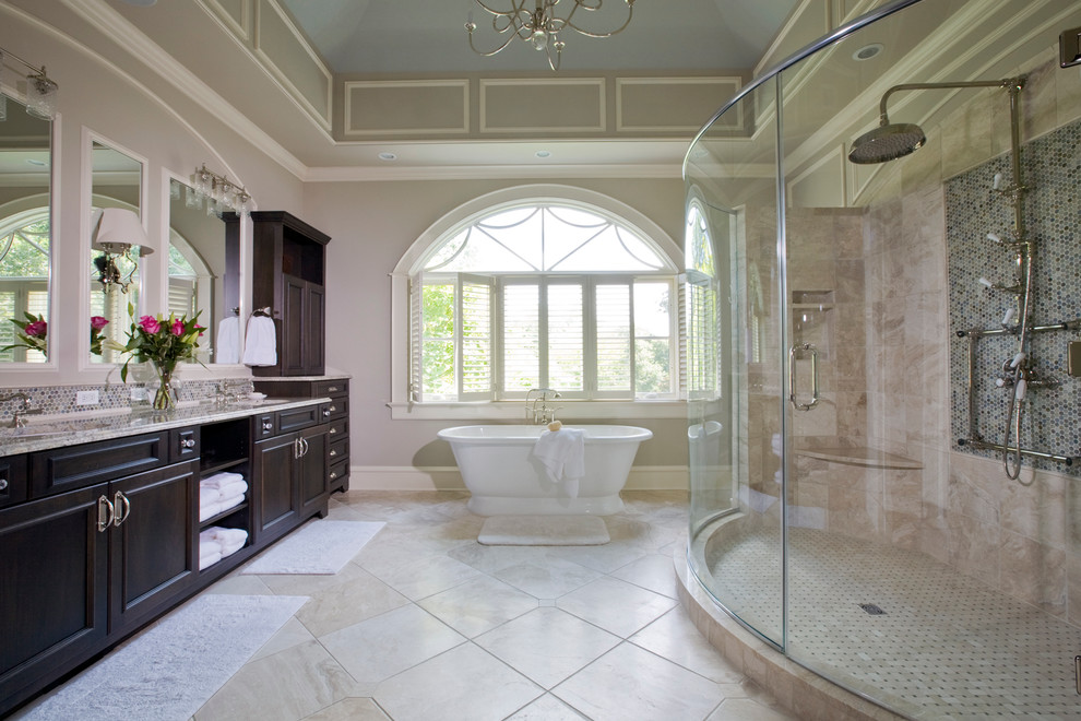 Huge ornate master beige tile and porcelain tile travertine floor bathroom photo in Baltimore with an undermount sink, recessed-panel cabinets, dark wood cabinets, gray walls and granite countertops