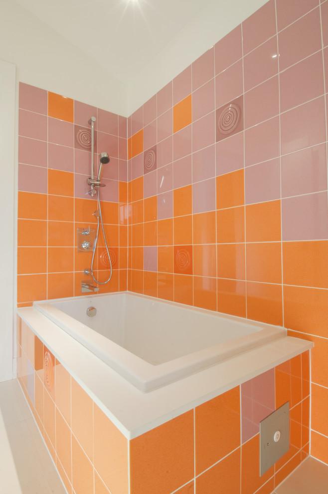 Bathroom - contemporary orange tile bathroom idea in Toronto