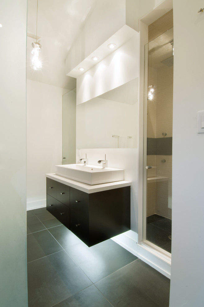 Bathroom - contemporary gray tile bathroom idea in Toronto with a trough sink, flat-panel cabinets and dark wood cabinets