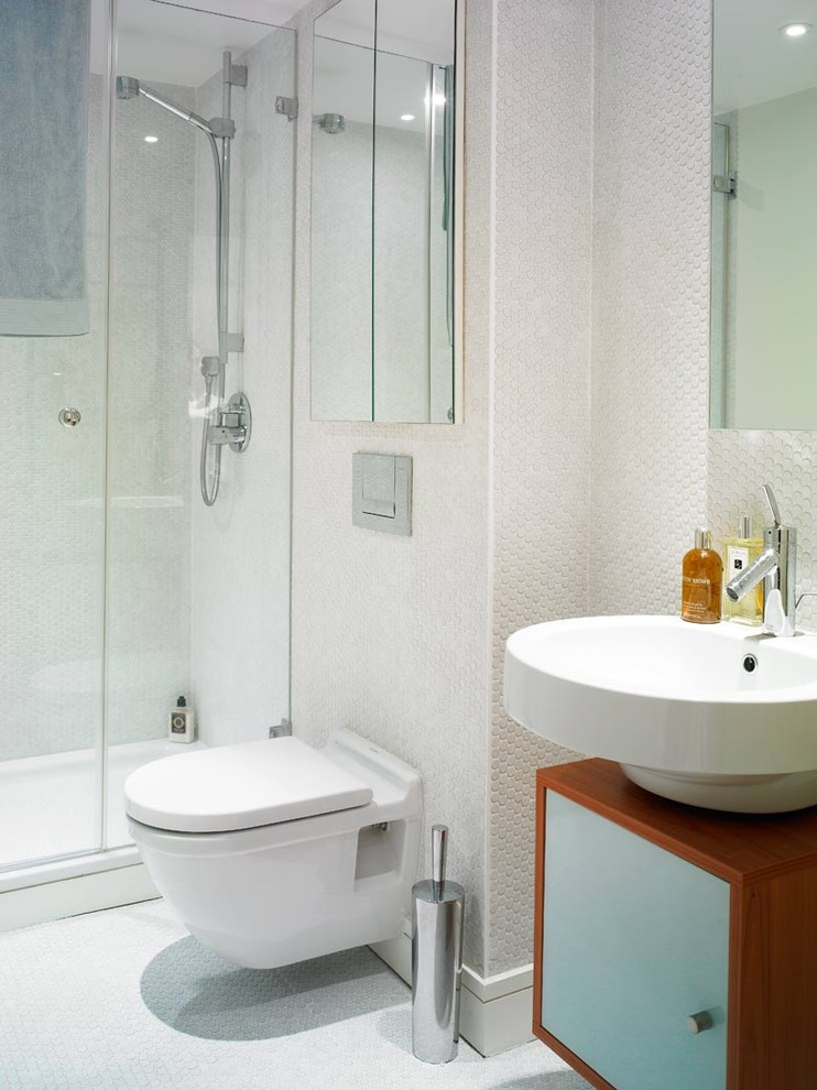 Inspiration for a modern bathroom remodel in Houston with a vessel sink and a wall-mount toilet