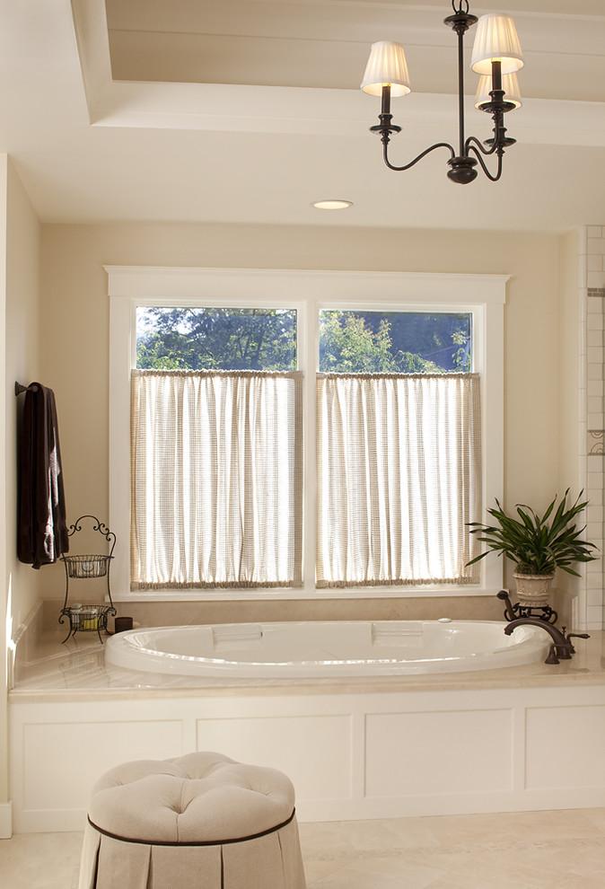 Drop-in bathtub - traditional beige tile drop-in bathtub idea in San Francisco