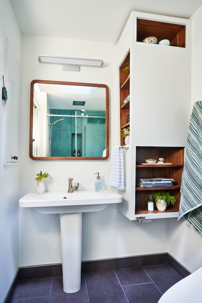 Bathroom - small contemporary master green tile and porcelain tile porcelain tile and gray floor bathroom idea in Portland with open cabinets, white walls, a pedestal sink and white cabinets