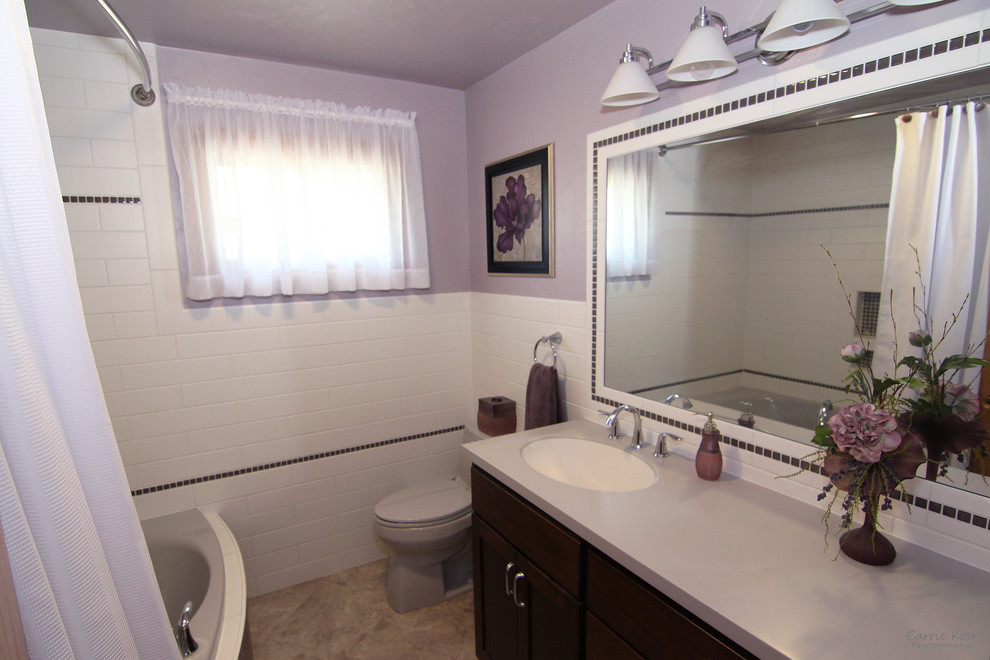 Bathroom - small transitional master white tile and subway tile vinyl floor bathroom idea in Milwaukee with flat-panel cabinets, dark wood cabinets, a two-piece toilet, purple walls, an integrated sink and solid surface countertops