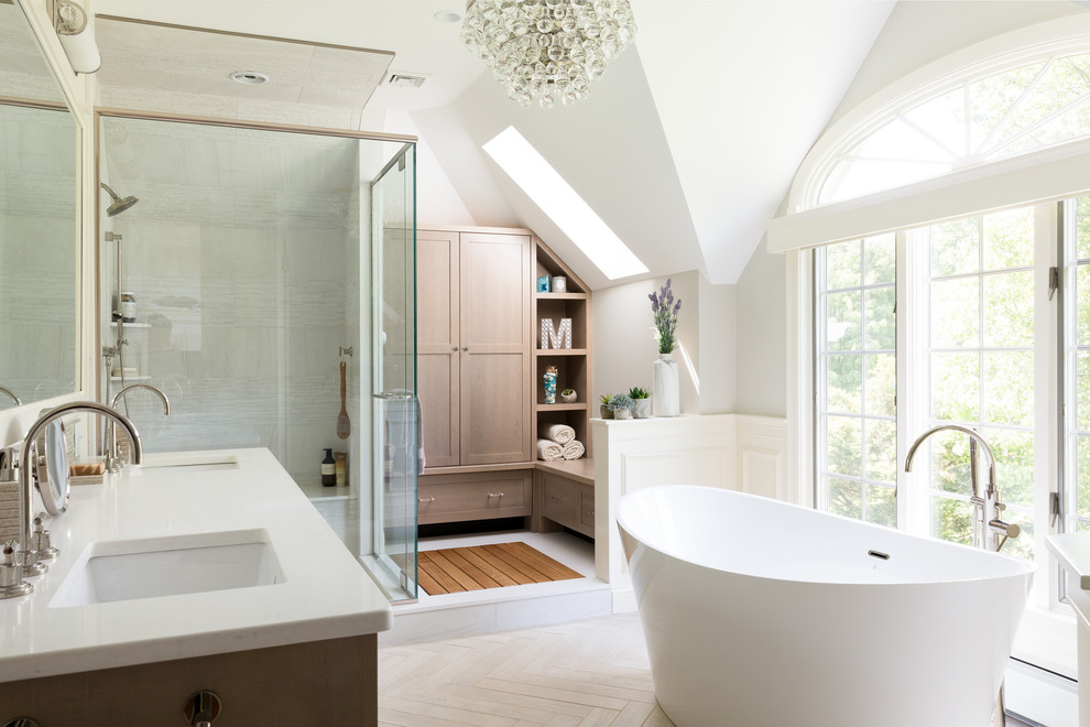 Inspiration for a transitional master beige tile beige floor bathroom remodel in Boston with shaker cabinets, medium tone wood cabinets, white walls, an undermount sink, a hinged shower door and white countertops